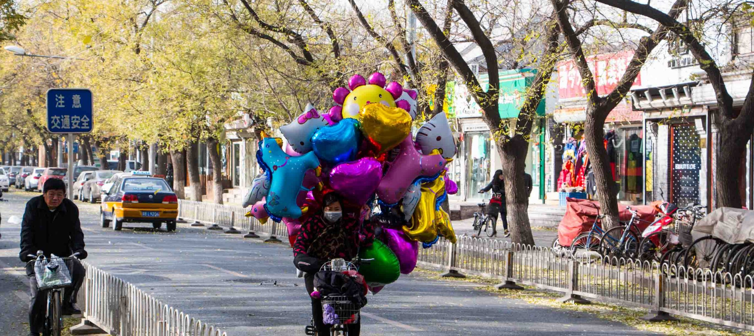 Man carrying balloons